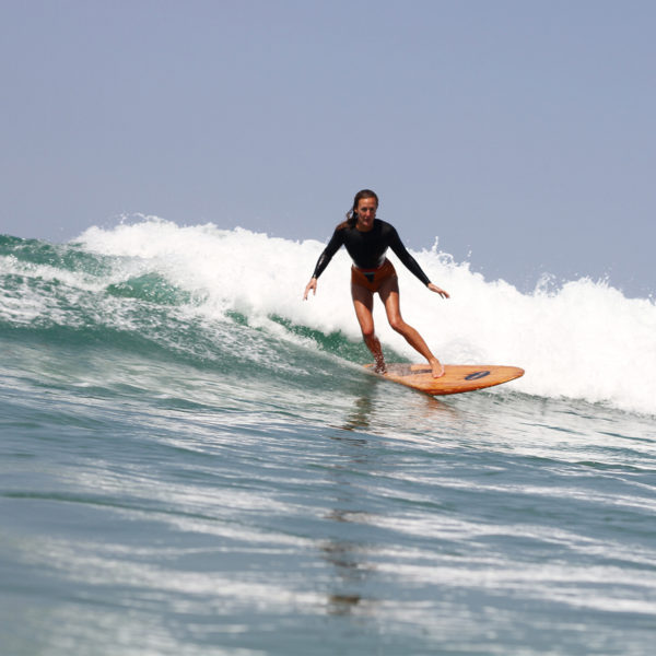 Sarah enjoys a wave on the Fetch at Chapel Porth, Cornwall. Otter Wooden surfboard