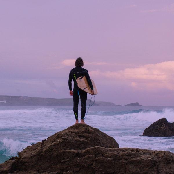 ADPT Film grab Alan Stokes x Otter Surfboards wooden surfboard Alan on the rocks