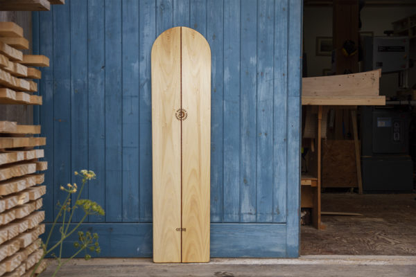 A collaborative bellyboard with surfers against sewage SAS wooden bellybord hand made in the otter workshop