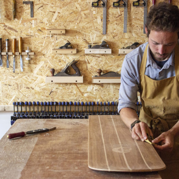 James Otter shaping a bellyboard for HRH Prince Charles, the prince of wales, the duck of cornwall for surfers against sewage with oak wood from highgrove house