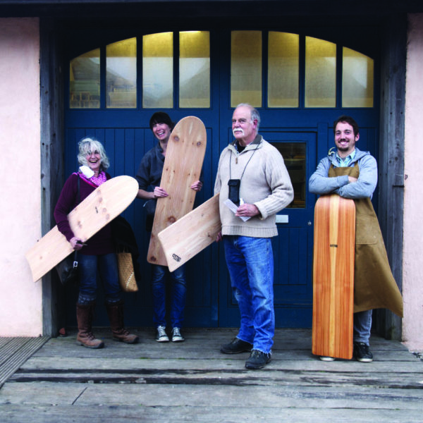 Wooden bellyboard group stood outside the otter surfboards workshop with James
