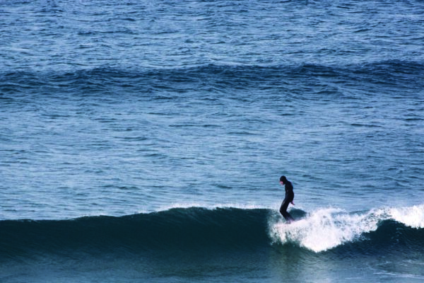 Mat Arney surfing the Otter Surfboards wooden Pier in mid-winter at Gwithian