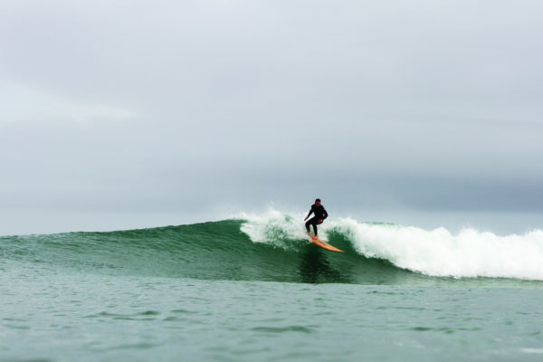 Chris top turns on the Pier. Otter wooden surfboards, Chapel Porth, Cornwall.