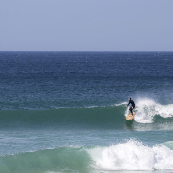 James Otter on his Wicket Wooden surfboard surfing in Cornwall