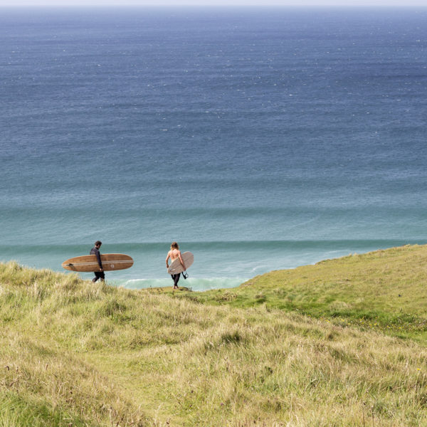 James Otter and Tom with wooden surfboards on the coast in Cornwall Wicket and Coaster