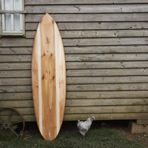 finished wooden surfboard deck otter surfboards workshop cornwall cutter