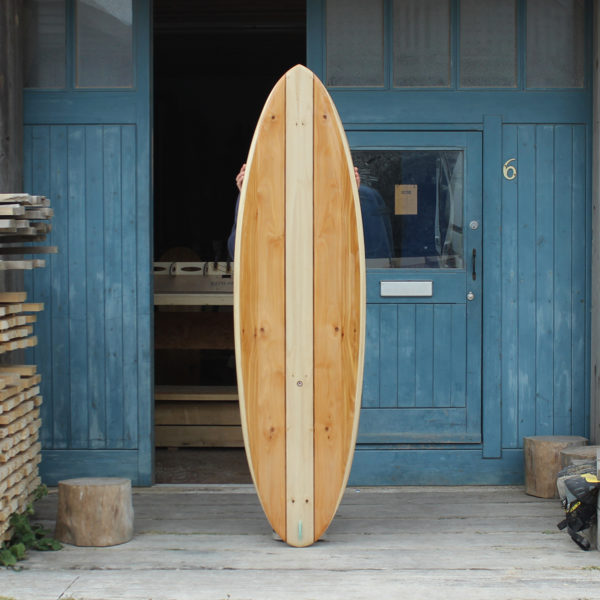finished wooden surfboard deck otter surfboards workshop cornwall cutter