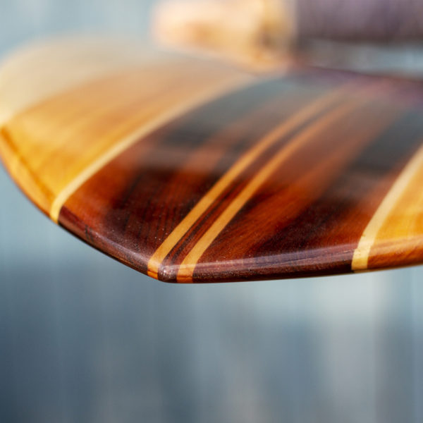 Detail of finished wooden surfboard nose otter surfboards workshop cornwall swift