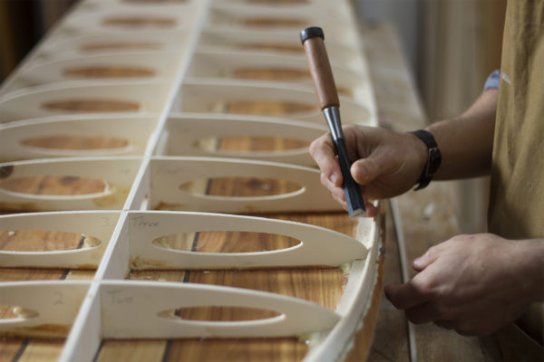 James Otter shaping wooden surfboard hand made handcrafted chisel workshop
