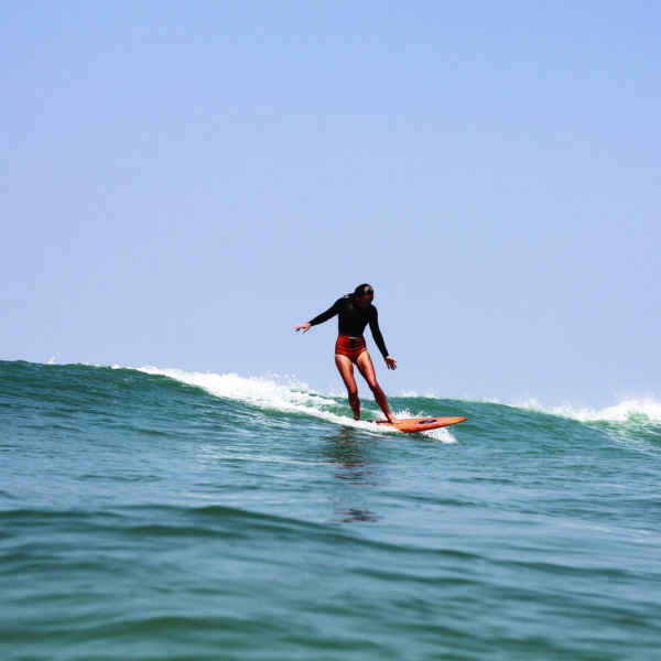 Sarah finding a wave on the otter surfboards Wood Burner Wooden surfboard at Chapel Porth, Cornwall Super stylish