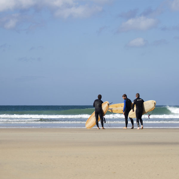 James Otter, Tony and Al on the beach at Godrevy with their wooden surfboards, wicket and coaster