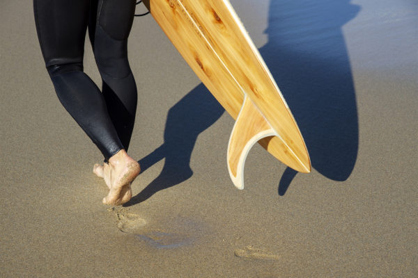 wooden surfboard and wooden fin james otter on the beach