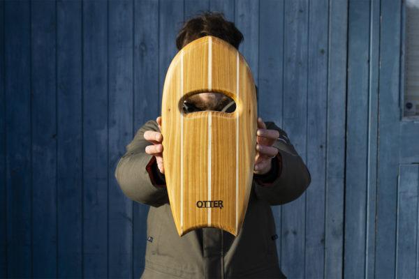 wooden bodysurfing handplane with triple pale layup crescent hand hole