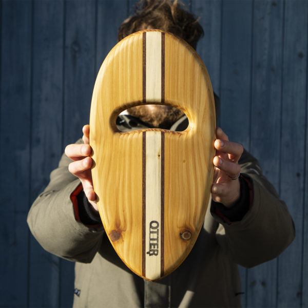 wooden bodysurfing handplane with sandwich layup pebble hand hole