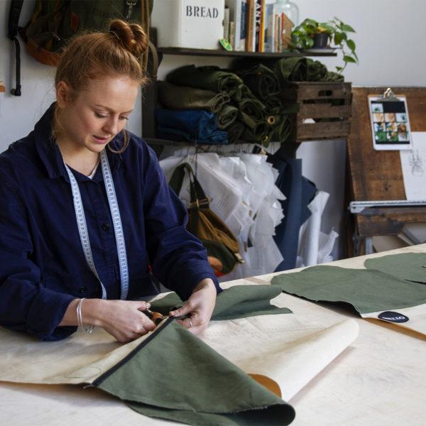 Ali at Francli Craftwear workshop making otter surfboards bellyboard bags