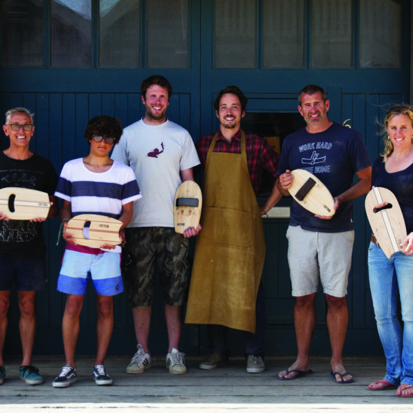 wooden bodysurfing handplane workshop group outside the otter surfboards workshop