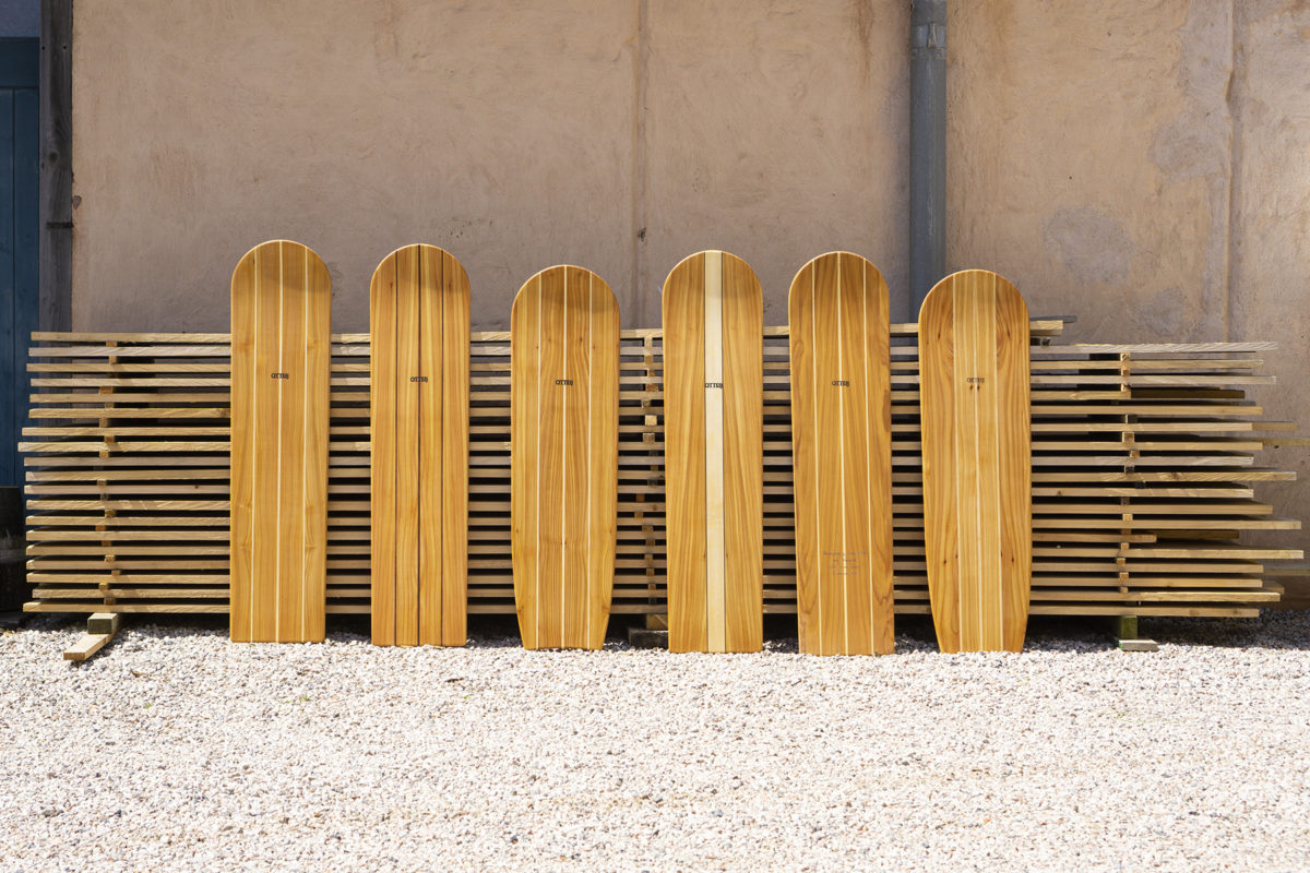 Full Line up of wooden bellyboards in front of the wood stack