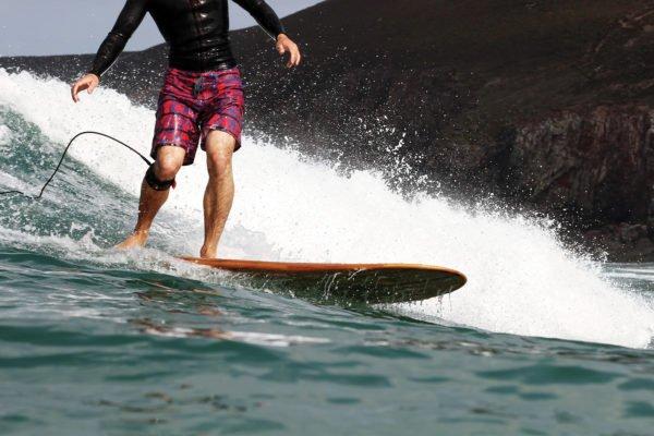 James Otter Riz Boardshorts Wooden Surfboard Seasaw Longboard back knee